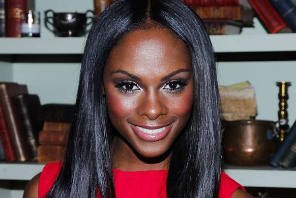 Tika Sumpter embraces a bold blush on her dark skin.
