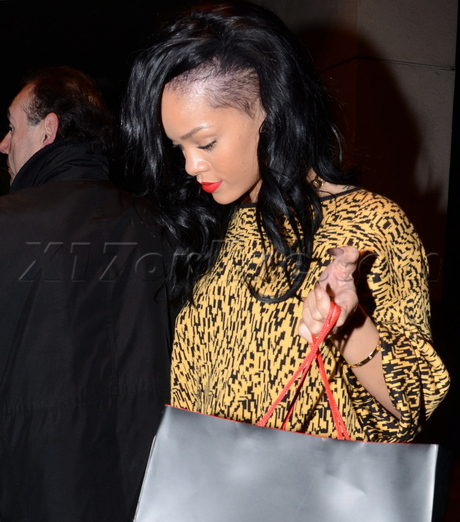 Rihanna showing off her new hair style at E baldi Italian restaurant