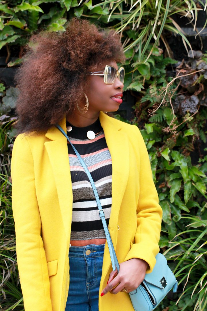 yellow coat afro hair clear glasses a